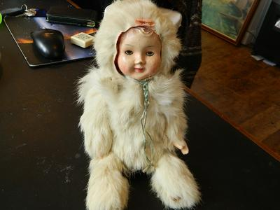 Real rabbit fur attached, wooden body and squeeks