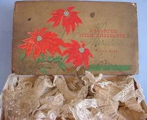 Old candy box with antique vintage laces group