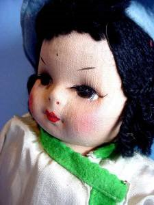 Vintage Georgene Oriental cloth girl left