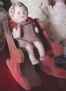 doll in rocking chair