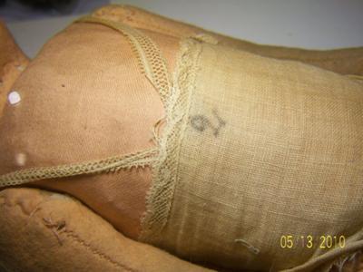 mark on dolls undergarment