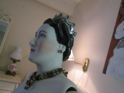 Doll side with jewels, earrings