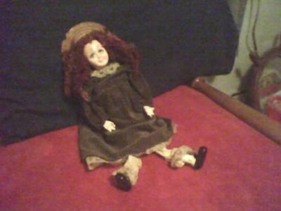 Help uncover truth behind mystery doll