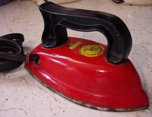red children's iron close up