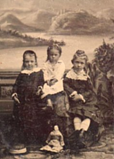 tin type 2 three children with doll