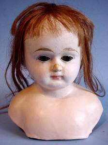 Early paper mache doll head front