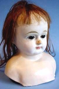 Early paper mache doll head side