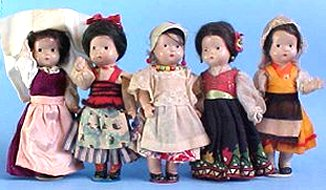 composition dolls dressed in costume