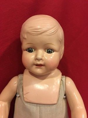 Boy doll with hole on top